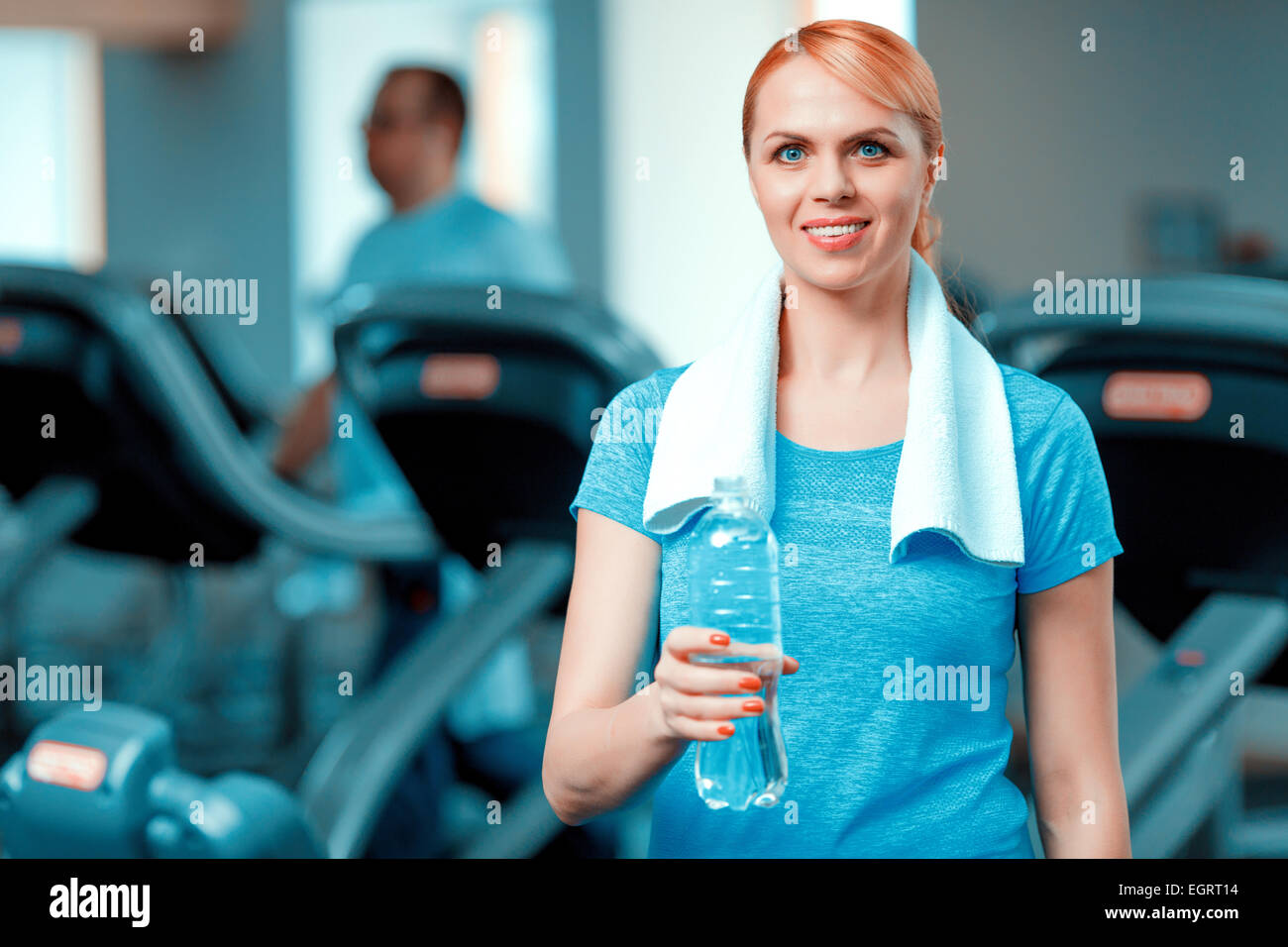 Attractive mature woman at sports club - Stock Image
