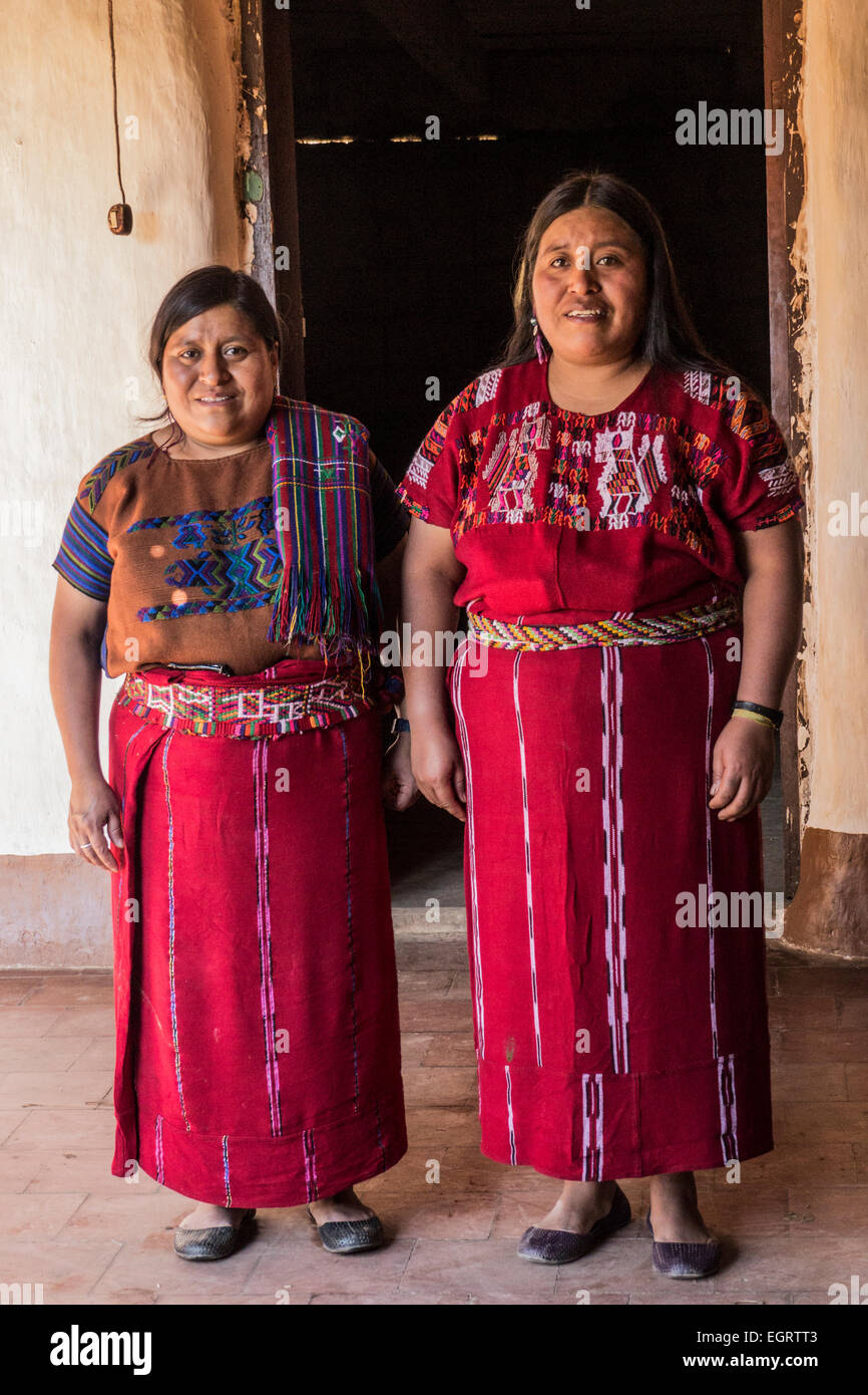 Portrait of two Ixil Maya indigenous women in the doorway of their house in Santa Maria Nebaj - Stock Image