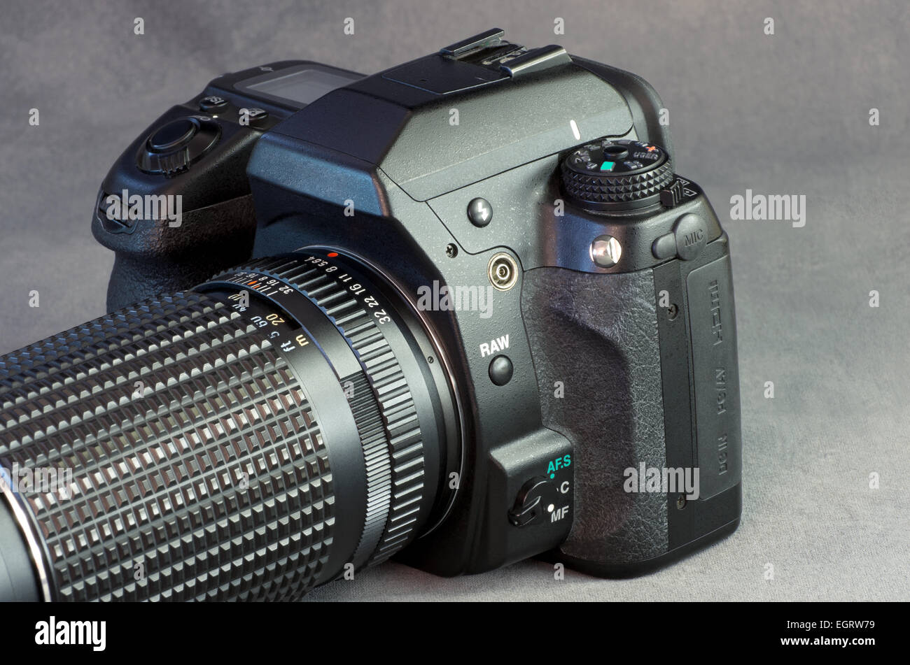 digital slr camera and lens closeup against gray background - Stock Image