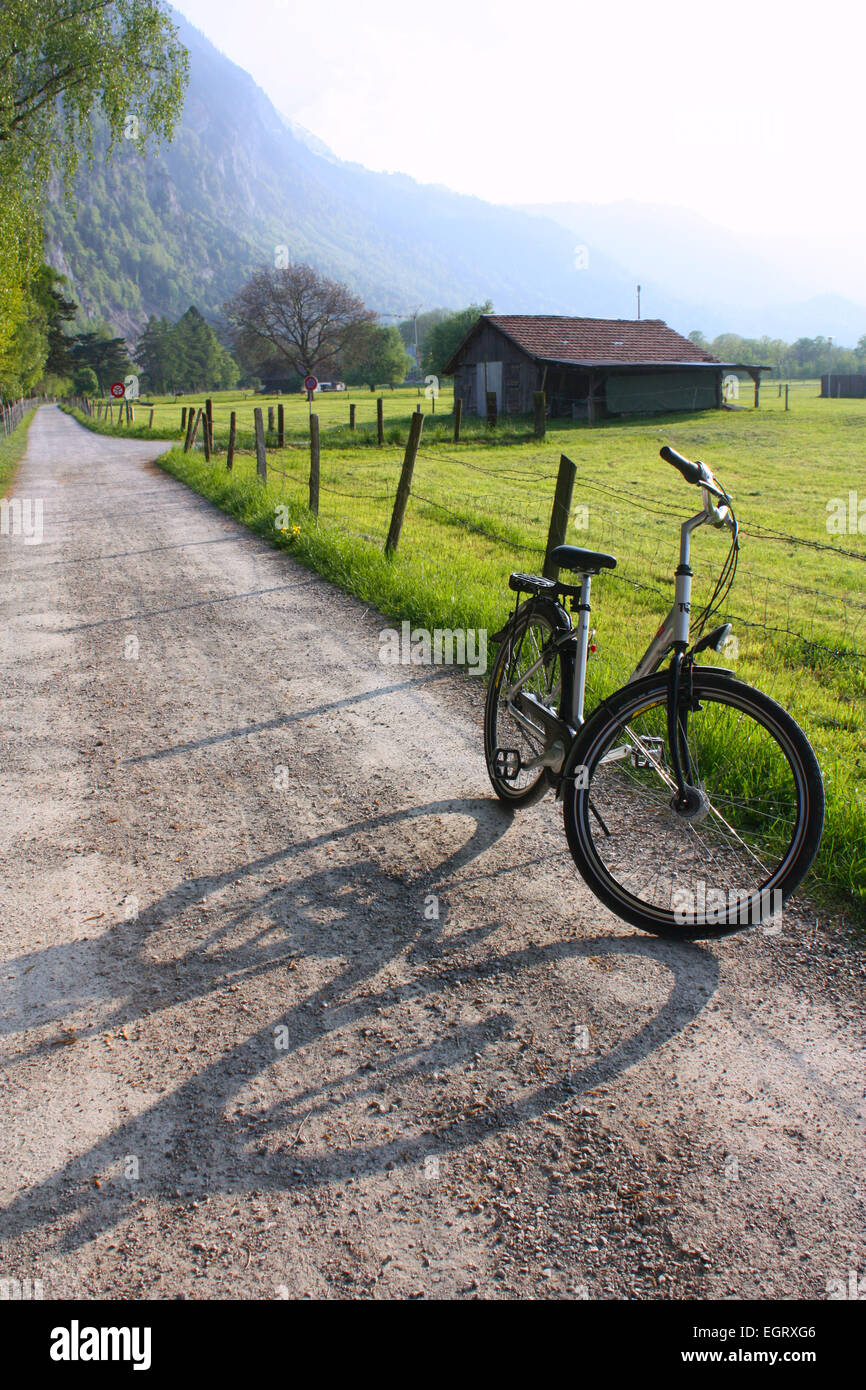 Two wheeler cycle in rural path in Interlaken, Switzerland Stock Photo