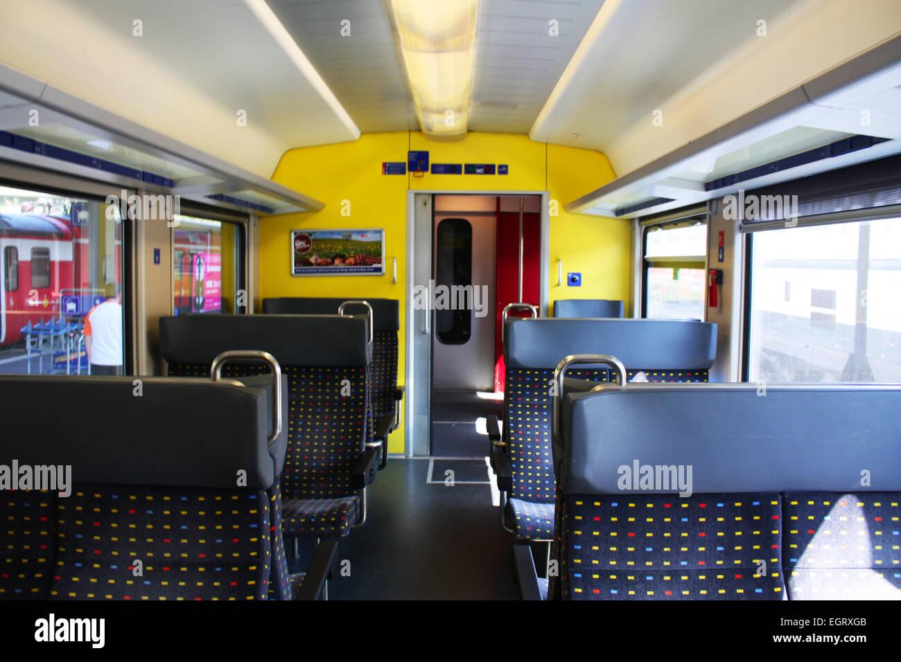 Seats inside a train in Switzerland Stock Photo
