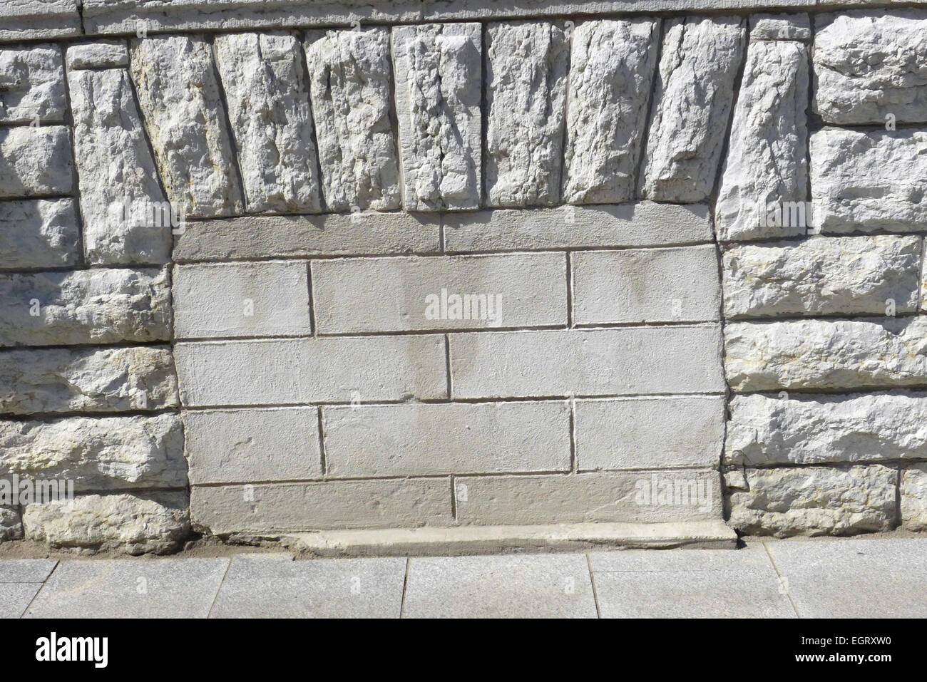 A cellar window of the former KGB building at 59 Pikk Street in Tallinn Estonia cemented up to block sounds of torture. Stock Photo