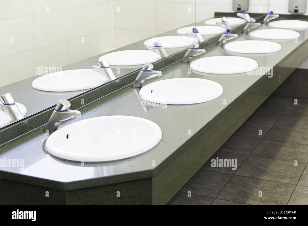 Sinks in a public toilets, sinks in detail about the city, public ...