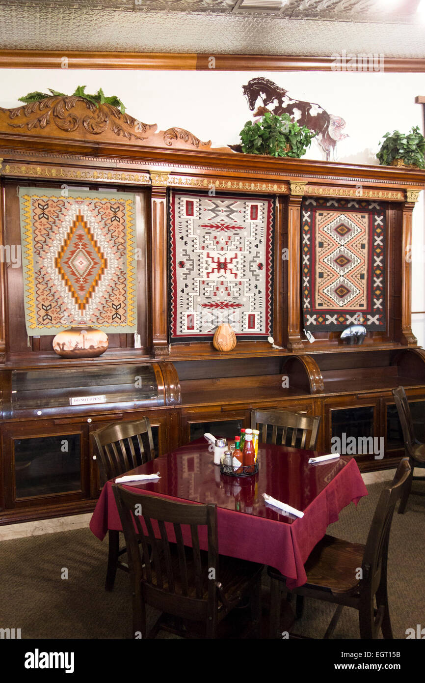 Navajo rugs decorate wall of dining room of Cameron Trading Post Arizona - Stock Image