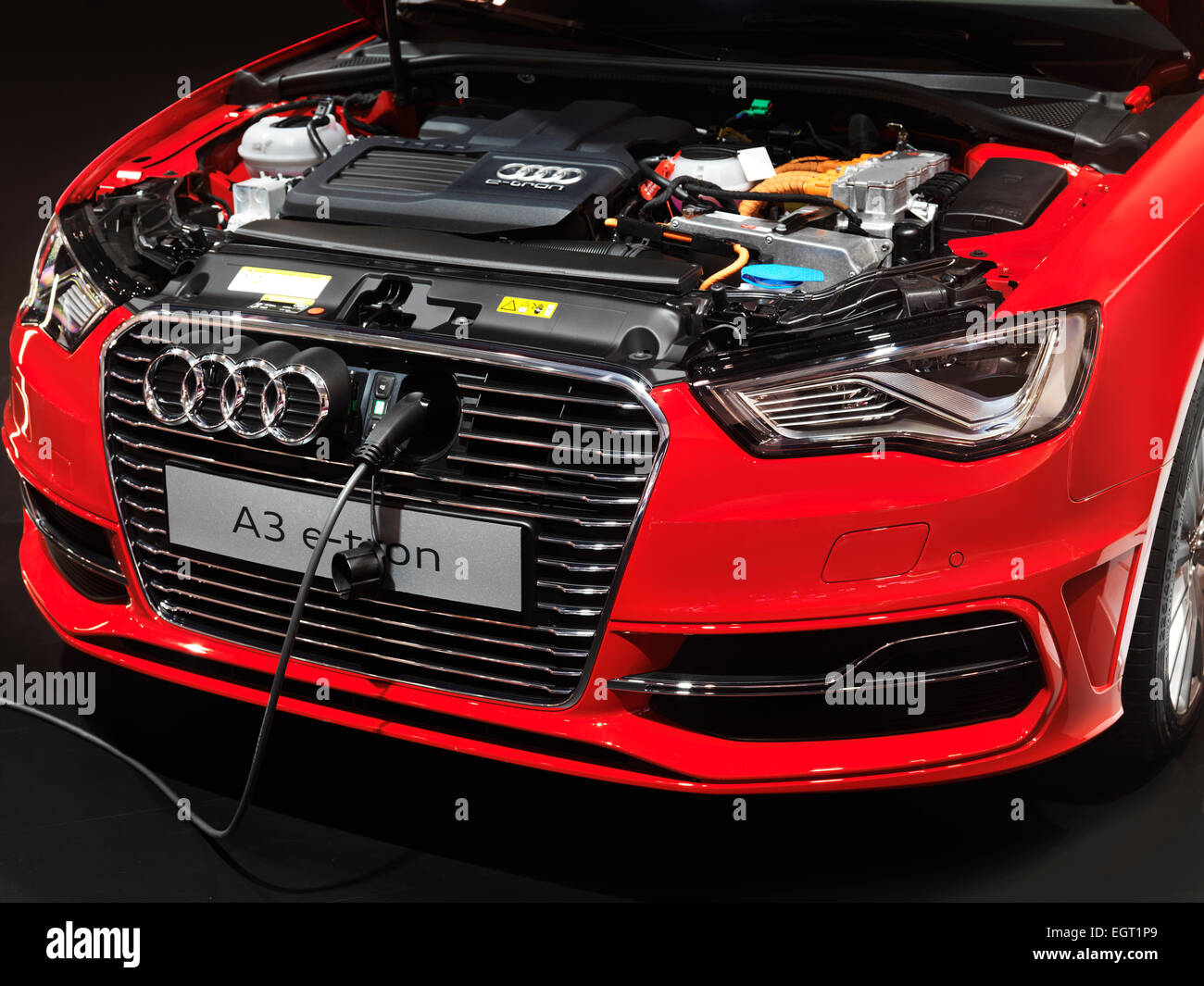 Closeup of Audi A3 e-tron electric car with a power plug being charged - Stock Image
