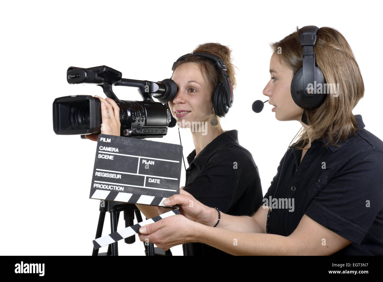 two young women with a video cameras on white Stock Photo  79205763 ... a3f25f6ba0