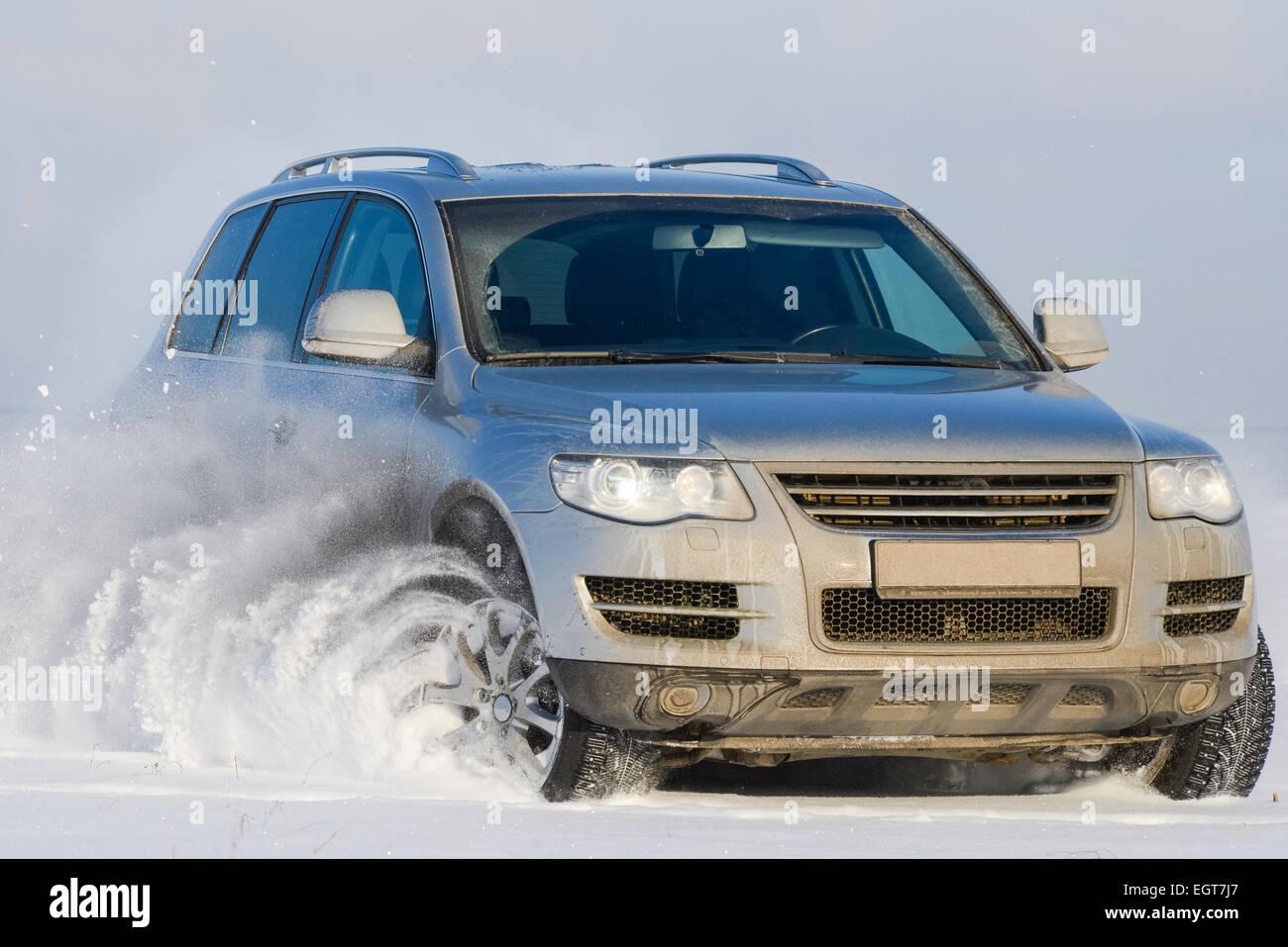 Car offroad spray snow - Stock Image