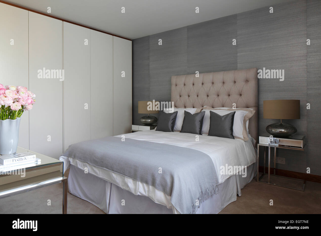 Guest Bedroom In Pale Blue Grey Colour Scheme With Pink Flowers In Uk Stock Photo Alamy