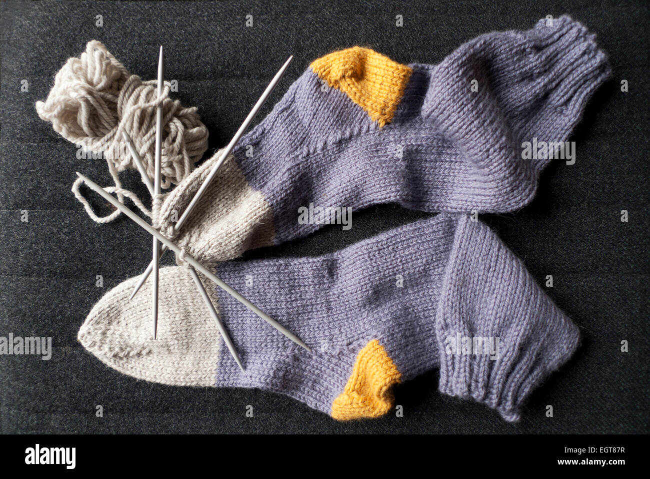 Handknitted purple, grey and yellow socks knitted in Nepal chunky wool, Carmarthenshire Wales UK  KATHY DEWITT - Stock Image
