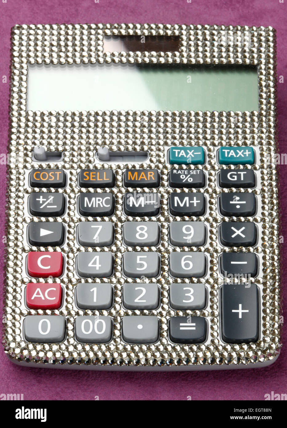 770c5e704 Calculator covered with swarovski crystals on table of velvet. - Stock Image