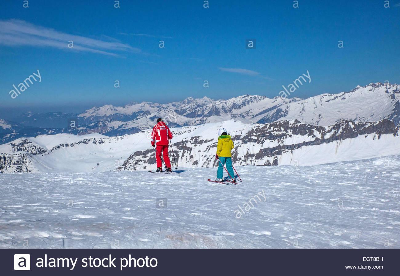 Haute-Savoie, ESF (french ski school) teacher with child - Stock Image