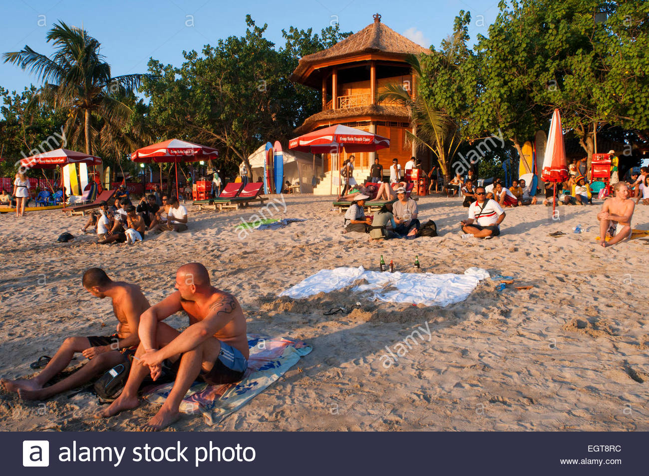Beach of Kuta at sunset. Surfing lessons. Bali. Kuta is a coastal town in the south of the island of Lombok in Indonesia. - Stock Image