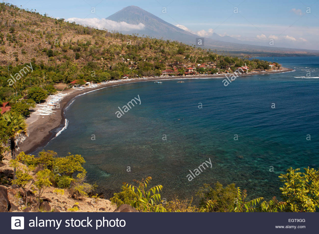 The small village of Amed fisherman with views of Mount Gunung Agung background (3142m). East Bali. Amed is a long - Stock Image