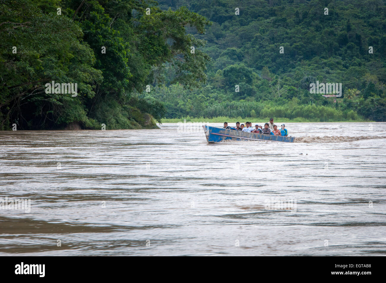Local People Travelling by Boat through Jungle on the Maranon River in Amazonas Region of Peru - Stock Image