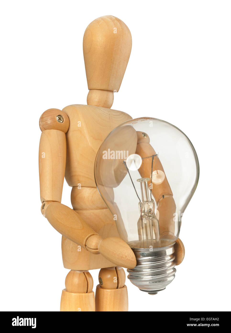 Wooden dummy that maintains a light bulb in hand on white background Stock Photo