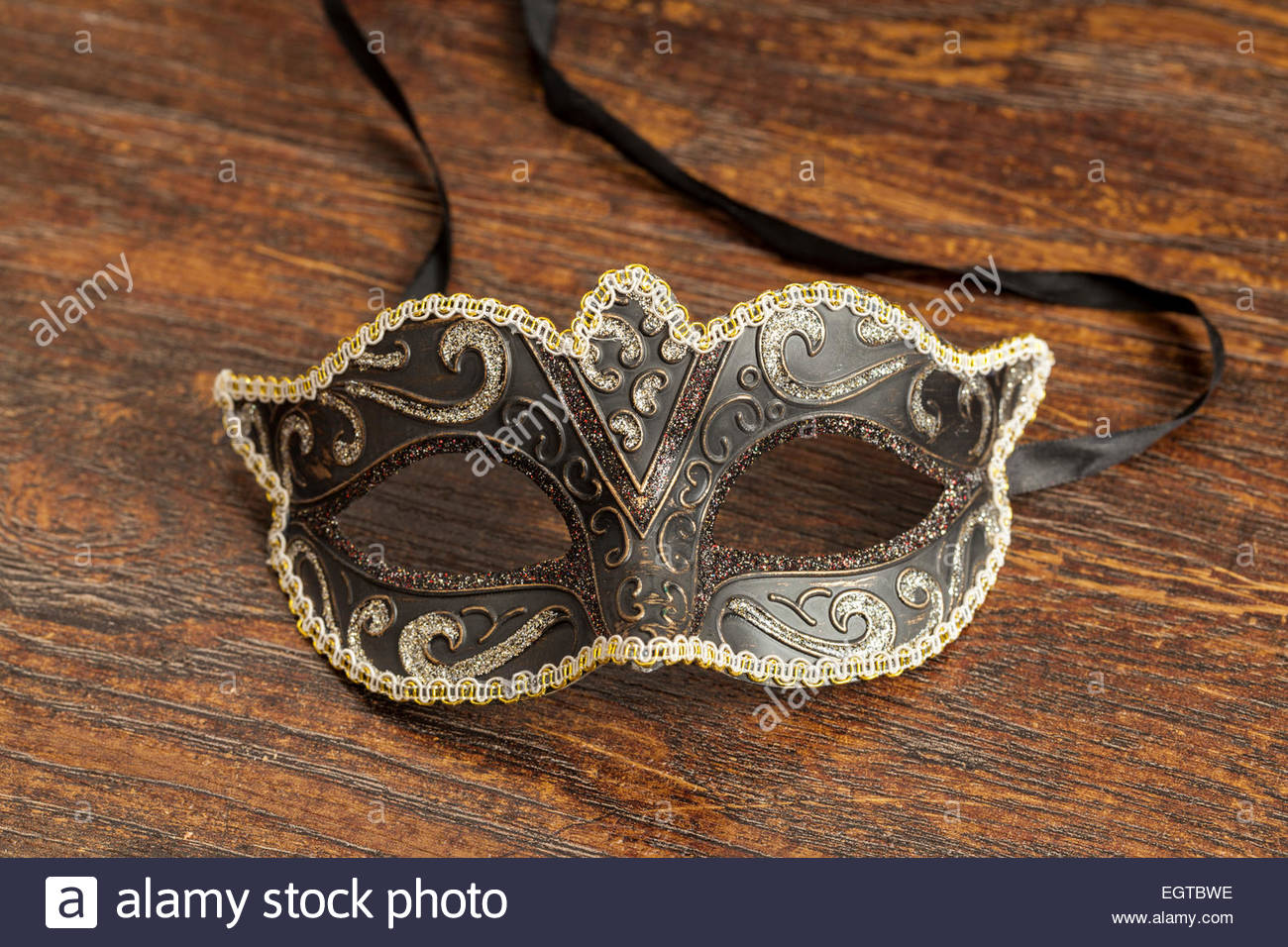 Black and Gold Theatrical Mask - Stock Image