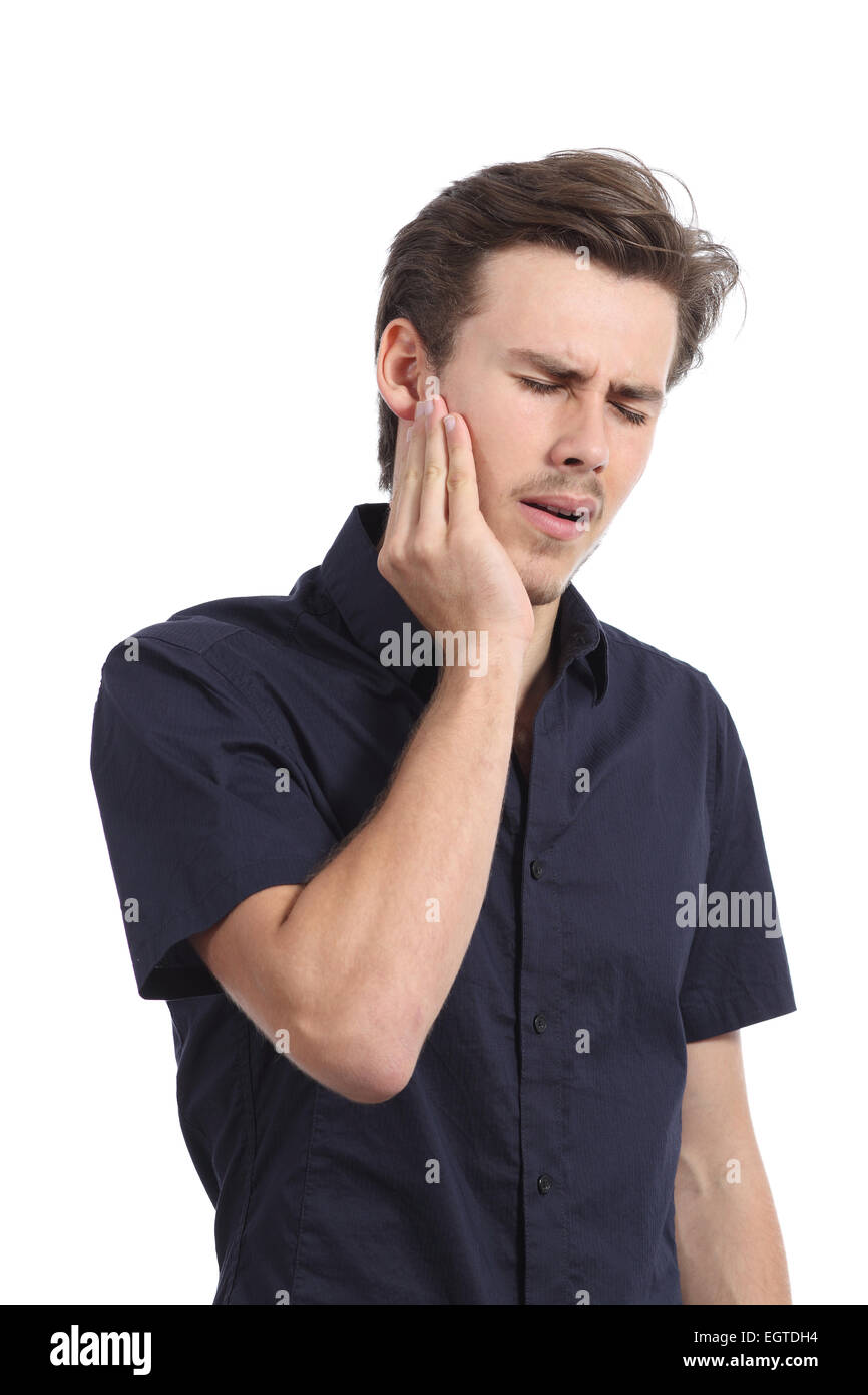 Casual man suffering toothache with hand pressing on face isolated on a white background - Stock Image