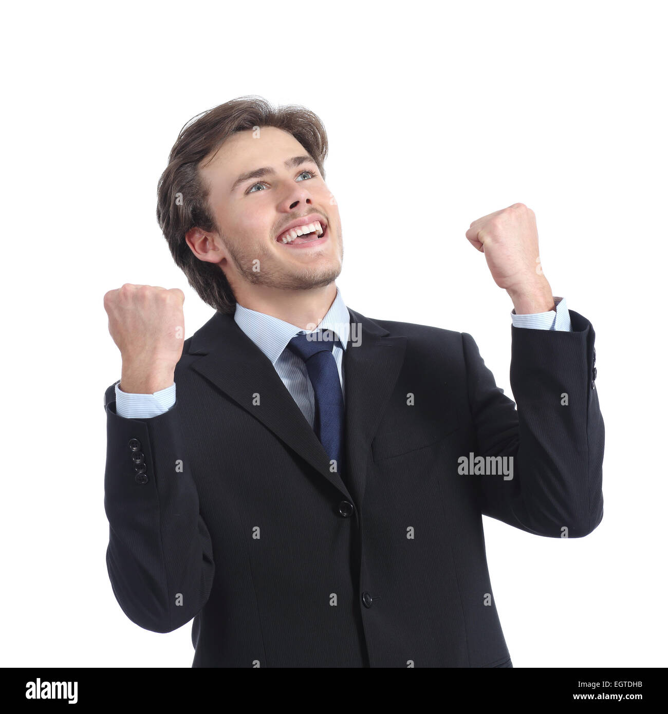 Euphoric successful businessman raising arms isolated on a white background - Stock Image