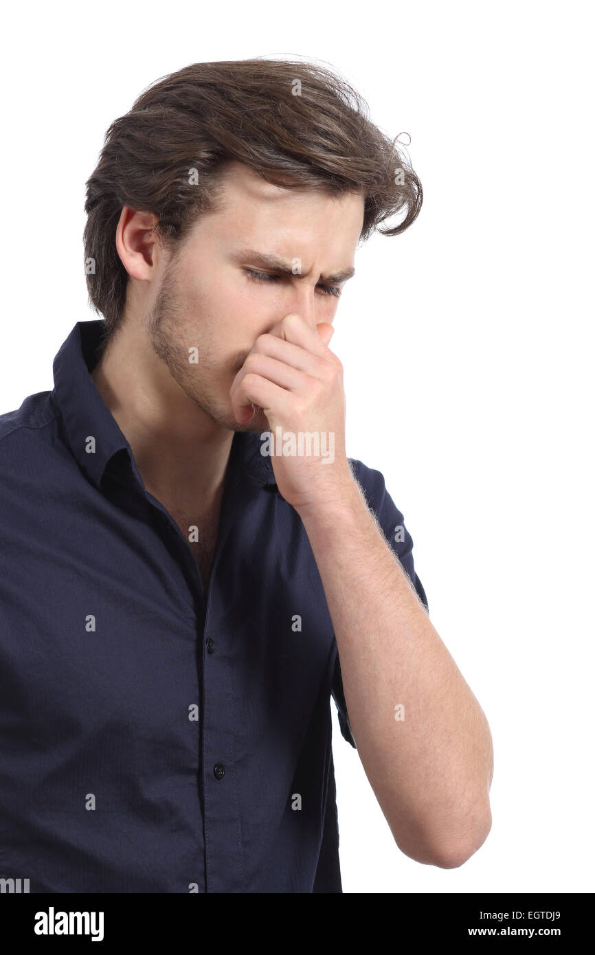 Man holding his nose because of the stink isolated on a white background - Stock Image