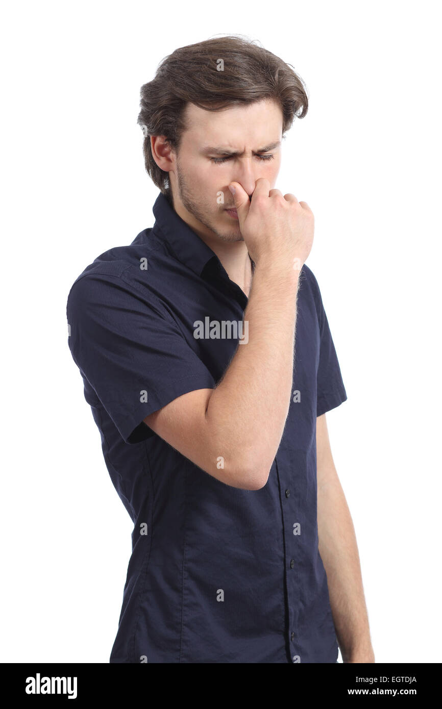 Man holding his nose smelling stink isolated on a white background - Stock Image