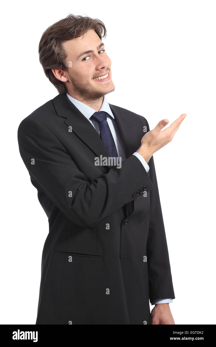 Young businessman presenting a blank promotion isolated on a white background - Stock Image
