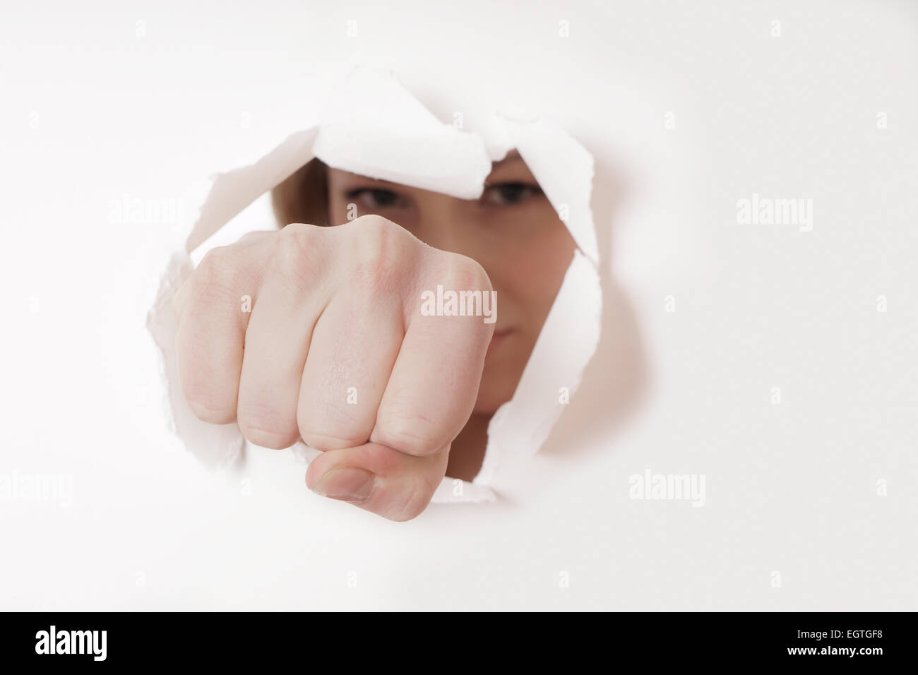 fist punching hole - Stock Image
