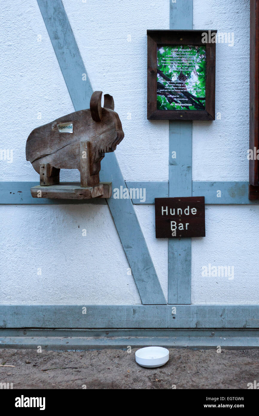 Germany, Schorfheide Game Reserve, Wildpark Schorfheide, Donation box and doggy bar with water bowl - Stock Image