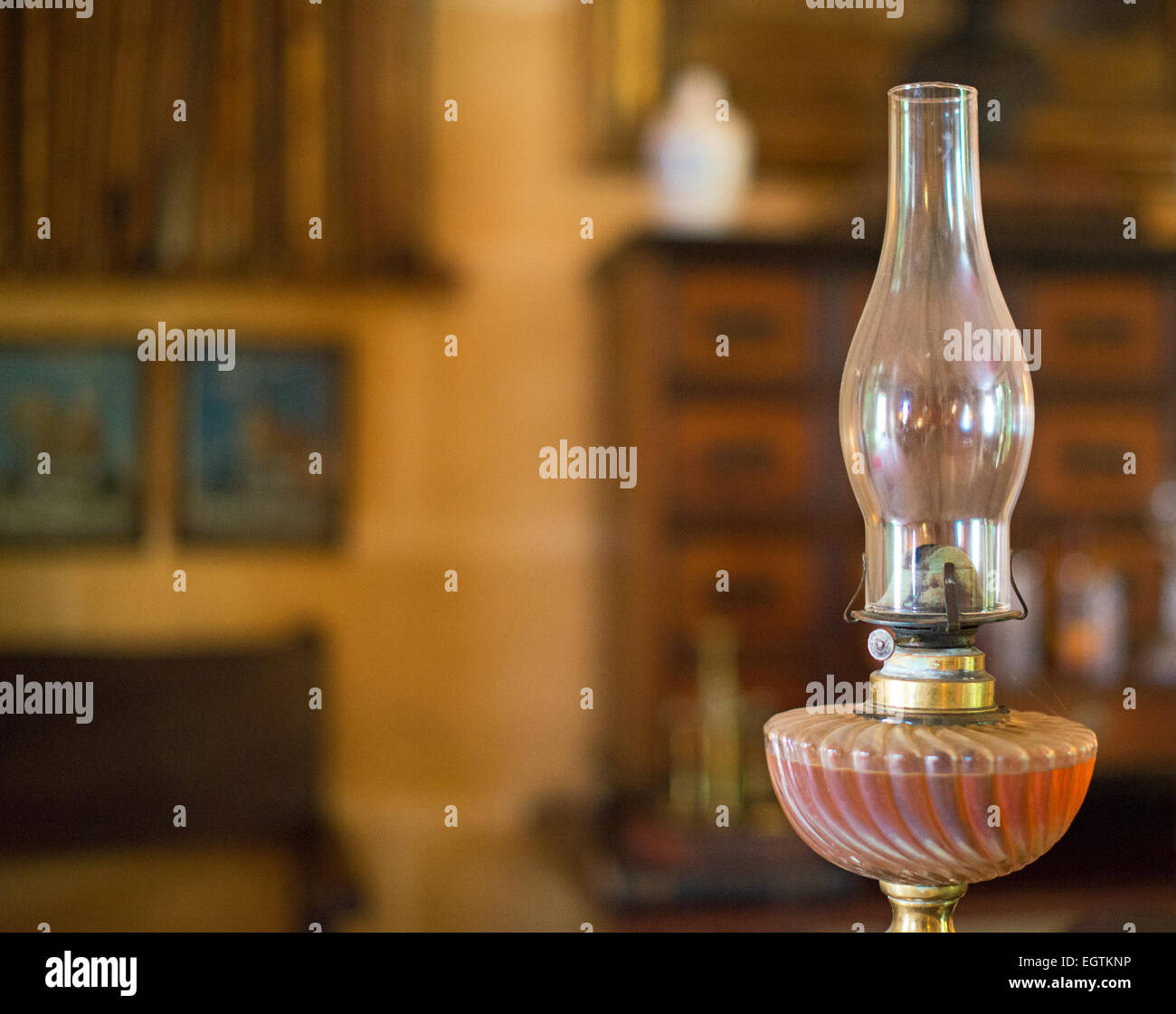 Antique oil lamp. Place for text. - Stock Image