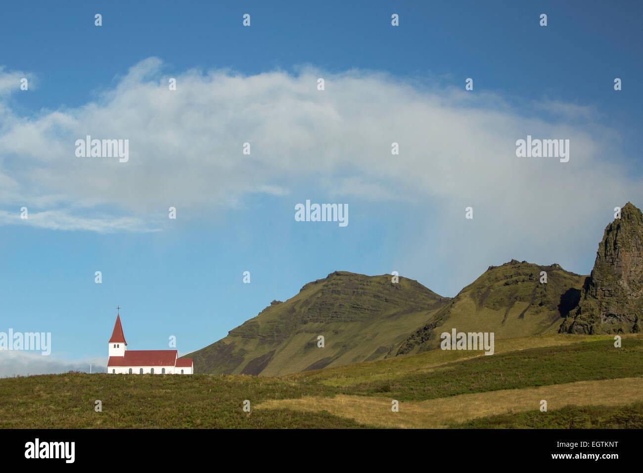 Rain cloud over Vik Church, Iceland - Stock Image