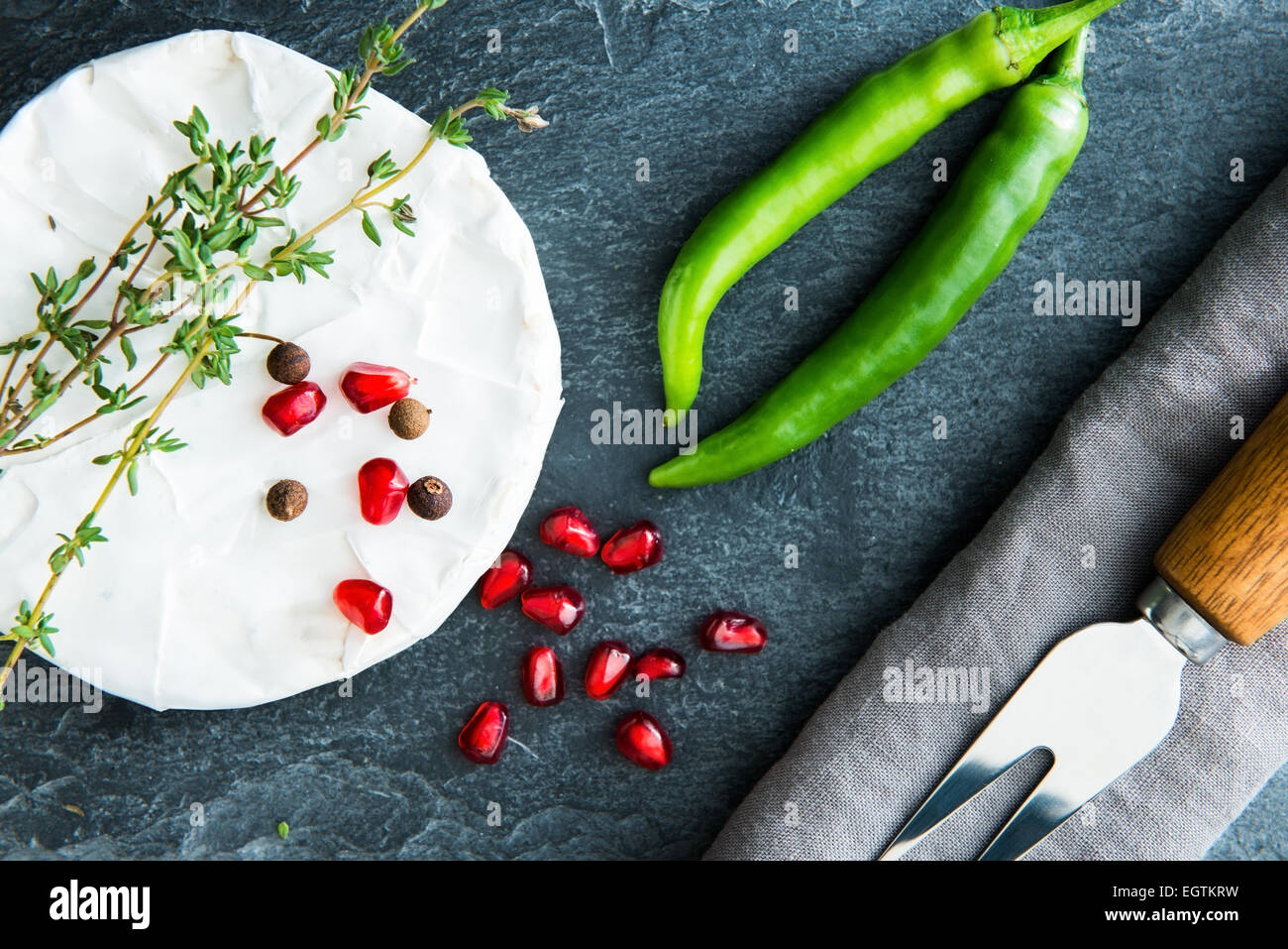 Closeup on camembert on stone substrate - Stock Image