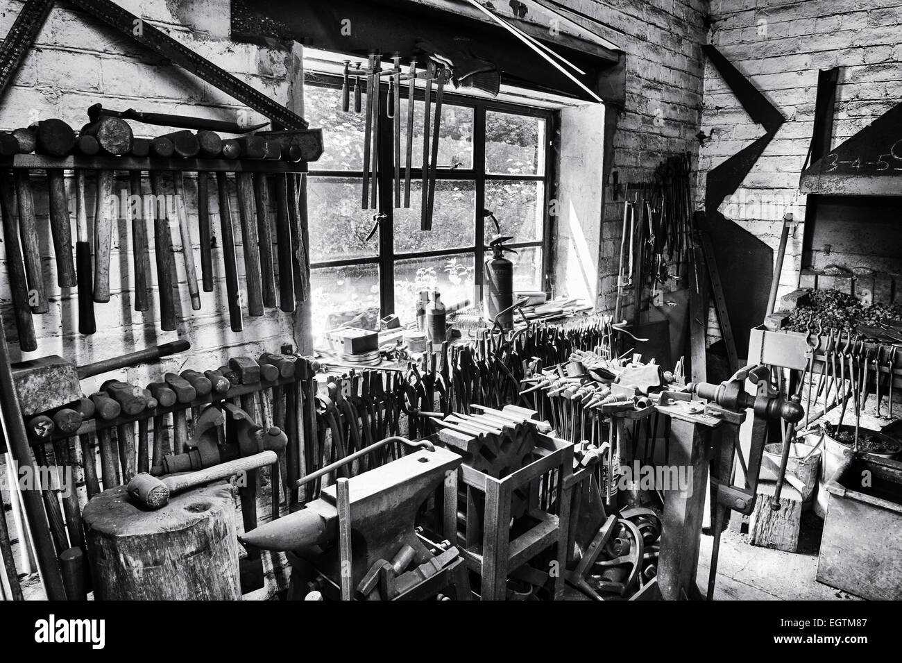 Blacksmiths workshop. Stoke Bruerne, Northamptonshire, England. Monochrome - Stock Image