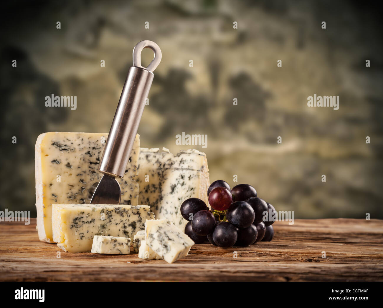 Still life of blue cheese served on wood in cellar - Stock Image