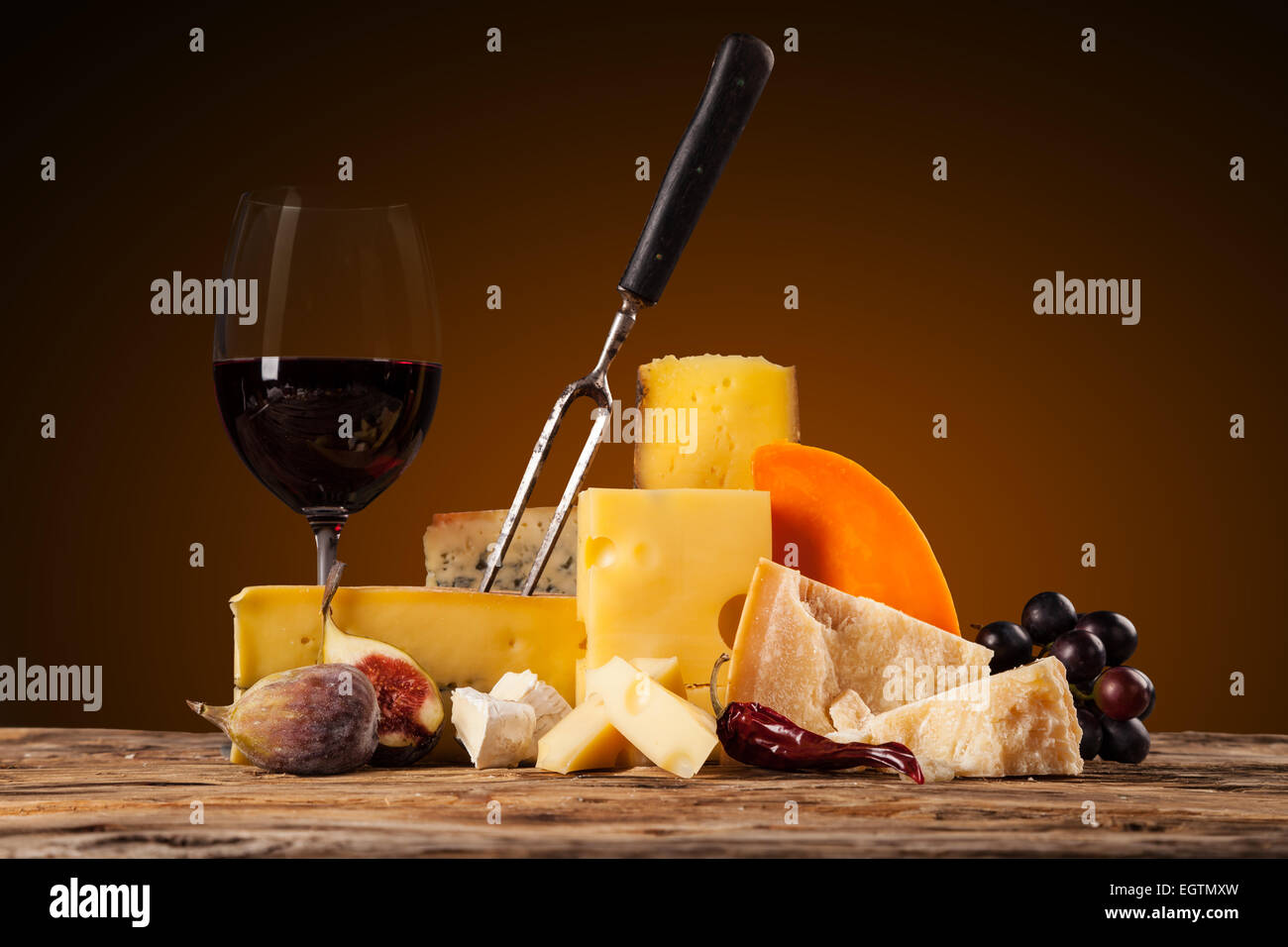 Various kind of cheese with red wine - Stock Image