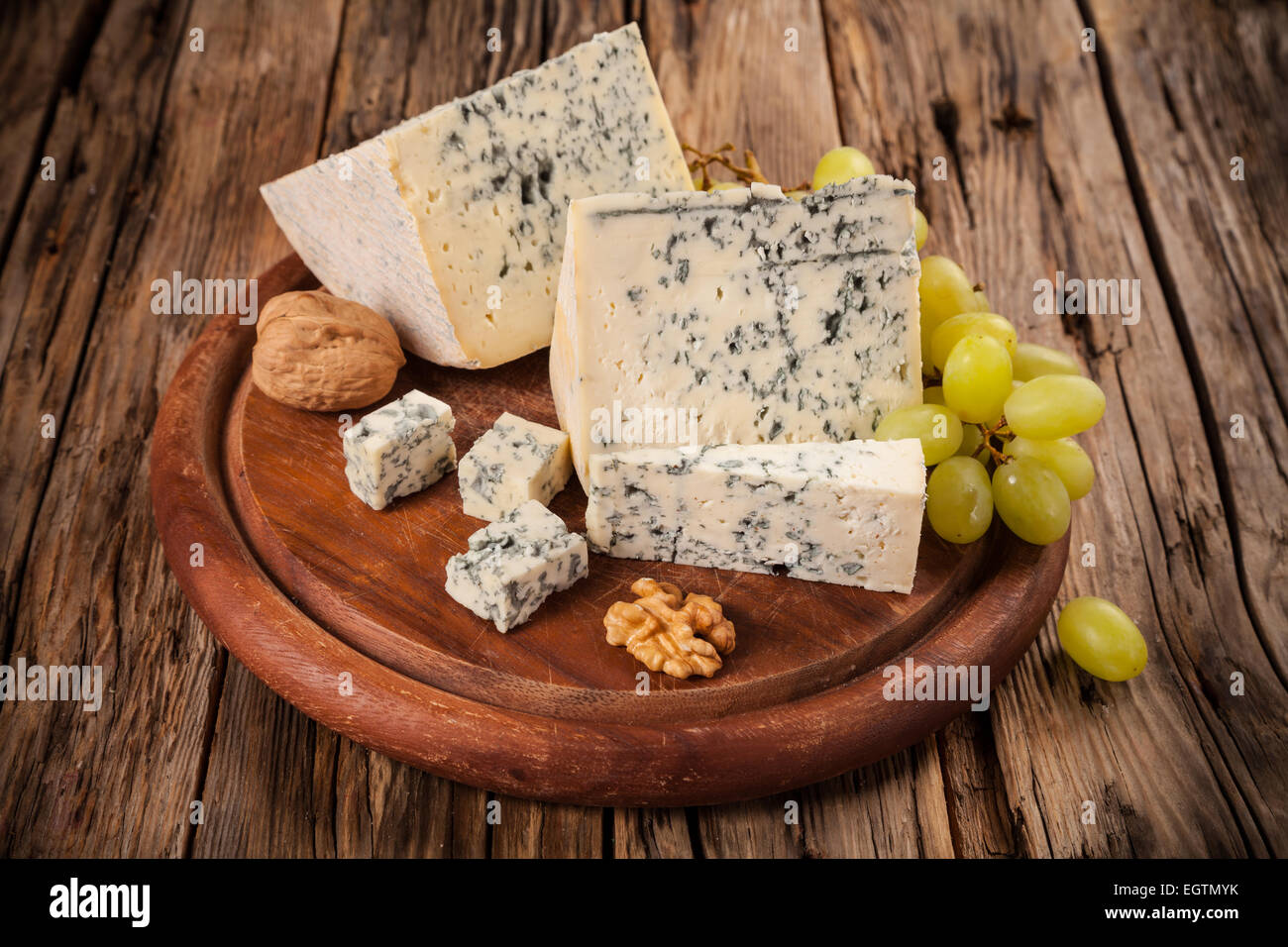 Still life of blue cheese served on wood - Stock Image