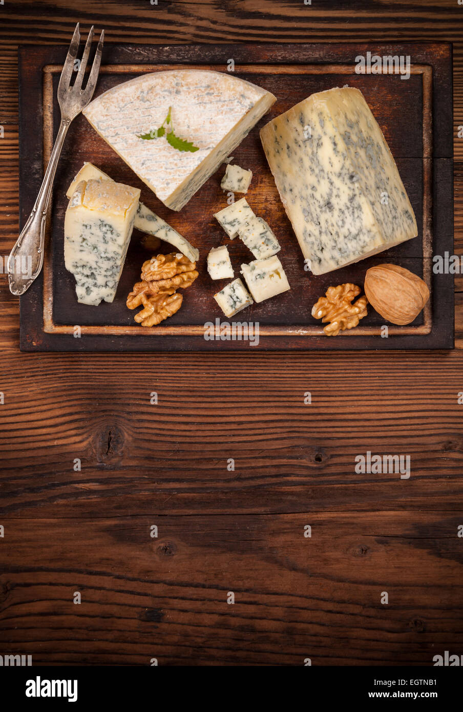 Still life of blue cheese served on wood. Shot from aerial view - Stock Image