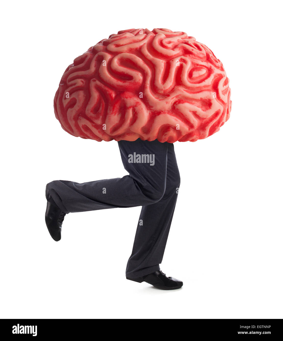 Metaphor of the brain drain. Rubber brain legs while running on white background. Stock Photo