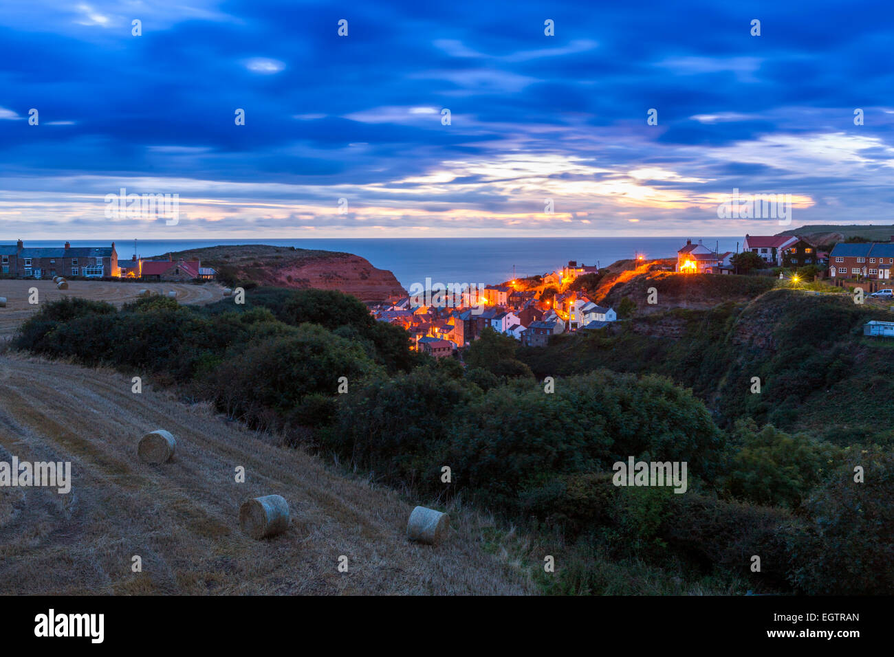 A view over the traditional fishing village of Staithes, North Yorkshire, England, United Kingdom, Europe. - Stock Image