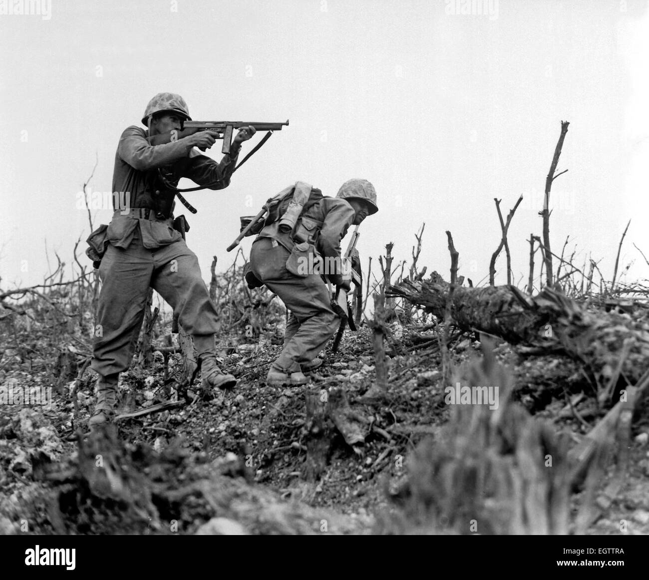 Marine fires on a Japanese position using an M1 Thompson submachine gun during an advance on Okinawa in 1945 - Stock Image