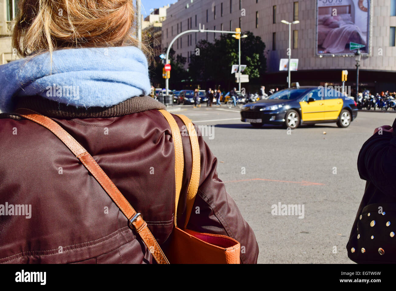 People waiting at a stoplight. Barcelona, Catalonia, Spain - Stock Image