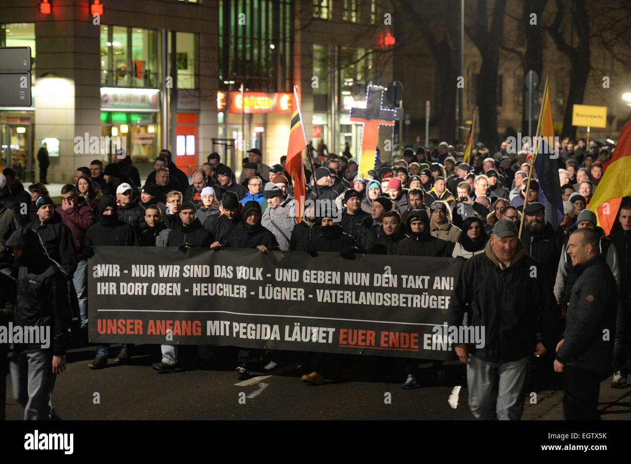Dresden, Germany. 2nd March, 2015. Supporters of the anti-Islam 'Pegida' movement demonstrate holding a - Stock Image