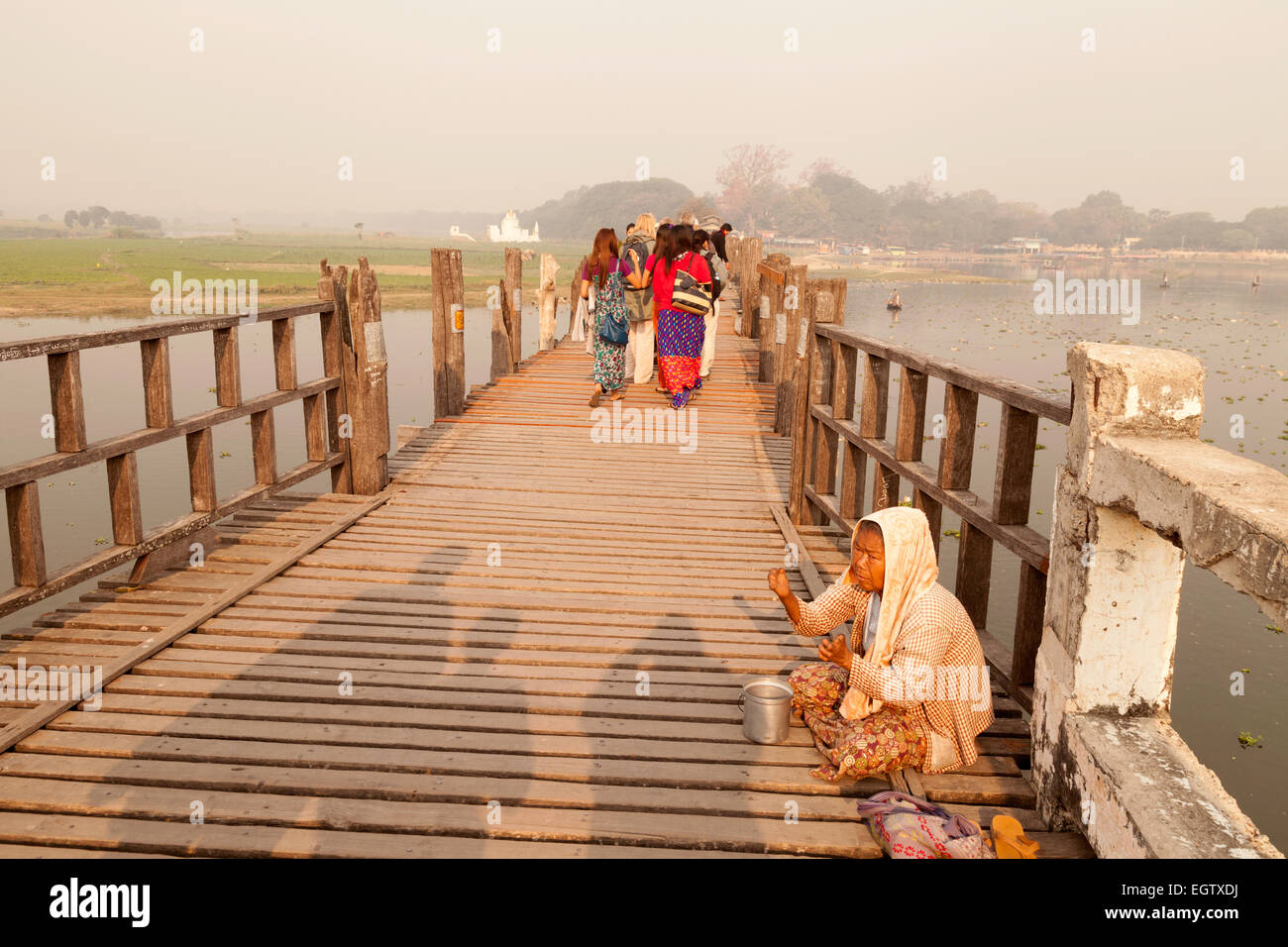 An old woman with leprosy ( a leper ), begging on the U bein bridge, Mandalay Myanmar ( Burma ), Asia - Stock Image