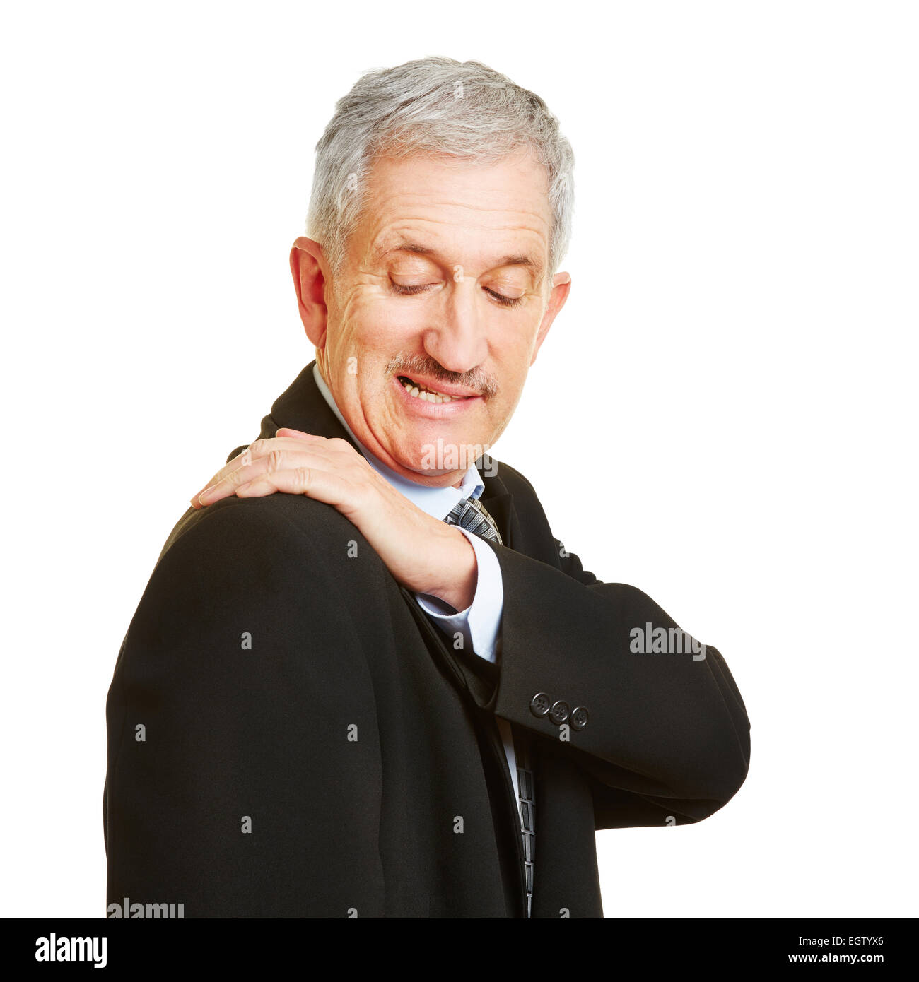 Old man having shoulder pain and holding his aching back - Stock Image