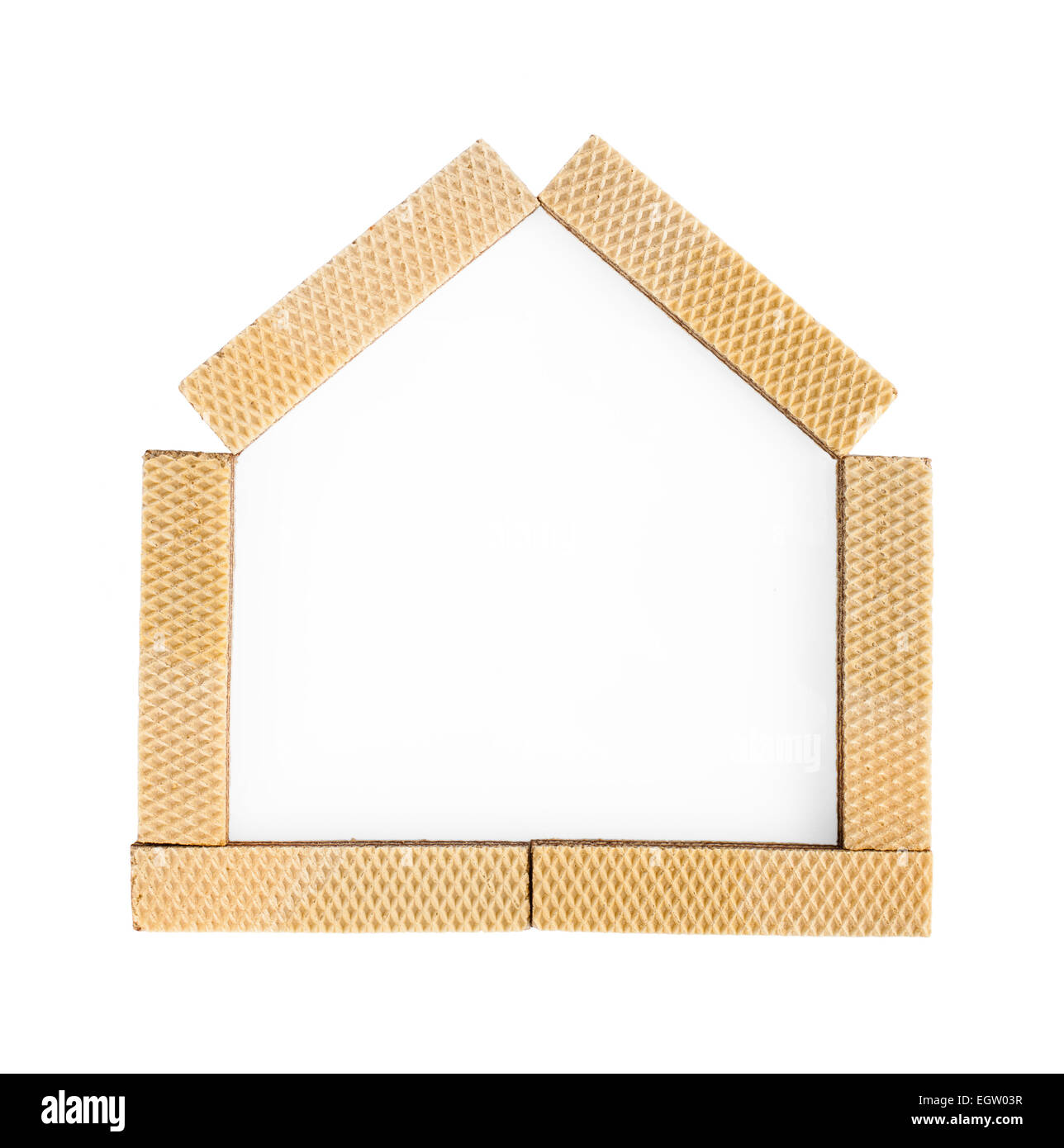 Metaphor of home sweet home with wafers on white background - Stock Image