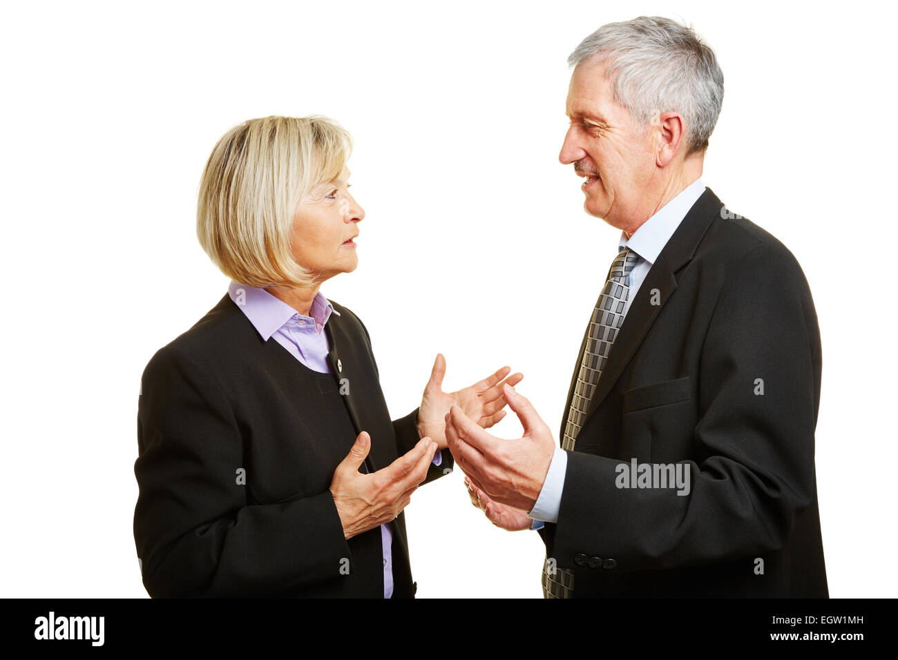 Two old businesspeople talking and argueing in a discussion - Stock Image