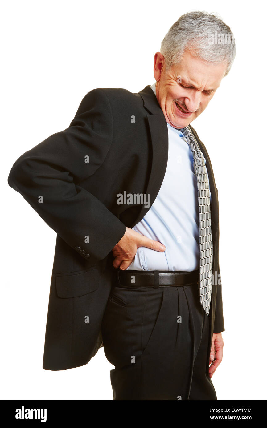 Old business man having back pain and holding hand to his aching back - Stock Image