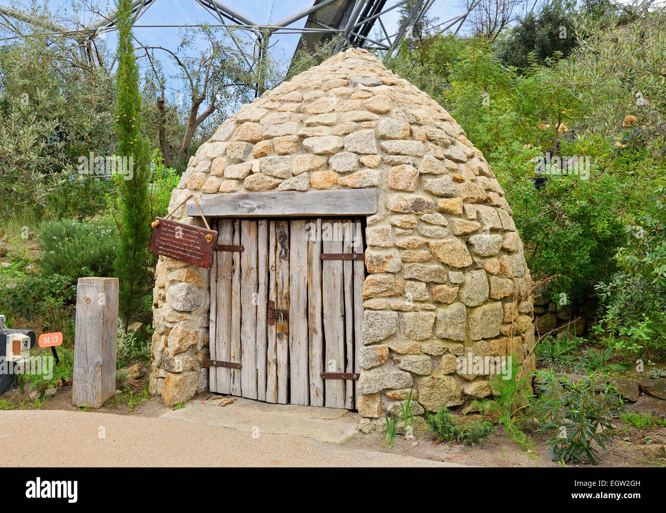 A traditional french Borrie ( a stone hut built to shelter shepherds ) exhibit at the Eden Project in Cornwall, - Stock Image