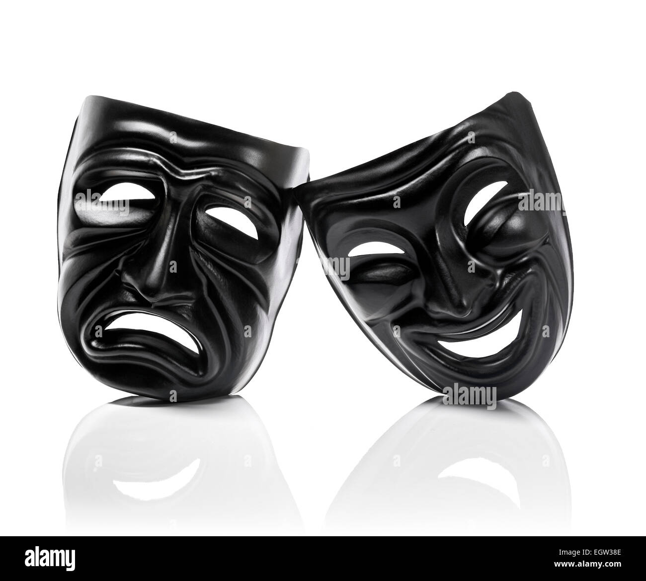 Generic plastic masks as theatrical symbols isolated on white with reflection - Stock Image