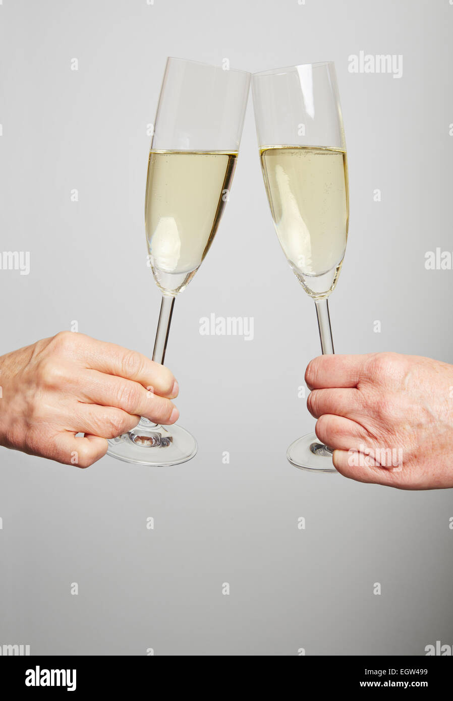 Drinking champagne in a glass for celebration at New Year's Eve - Stock Image