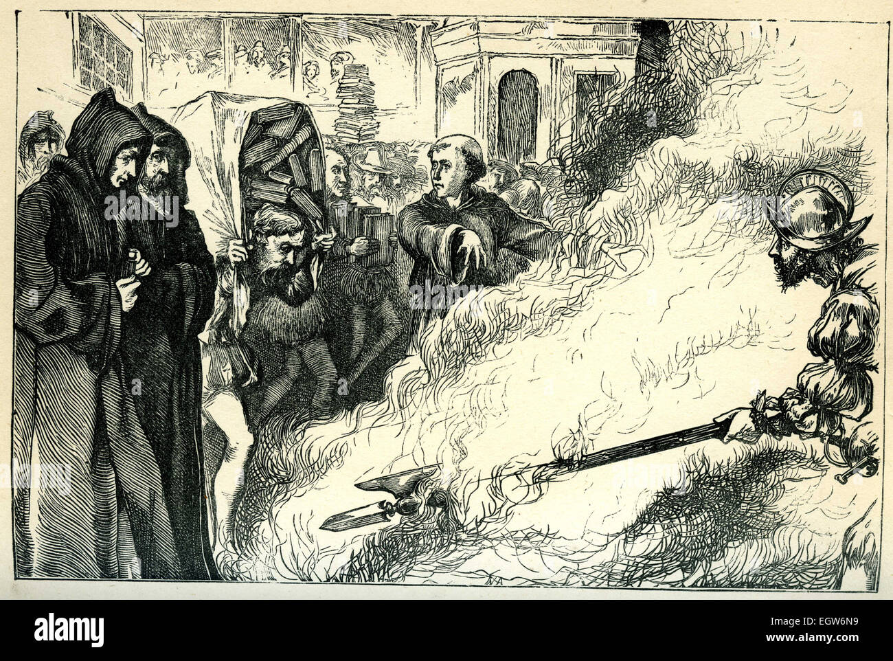 Catholics burn copies of William Tyndale's translation of the New Testament into English in 1525. - Stock Image