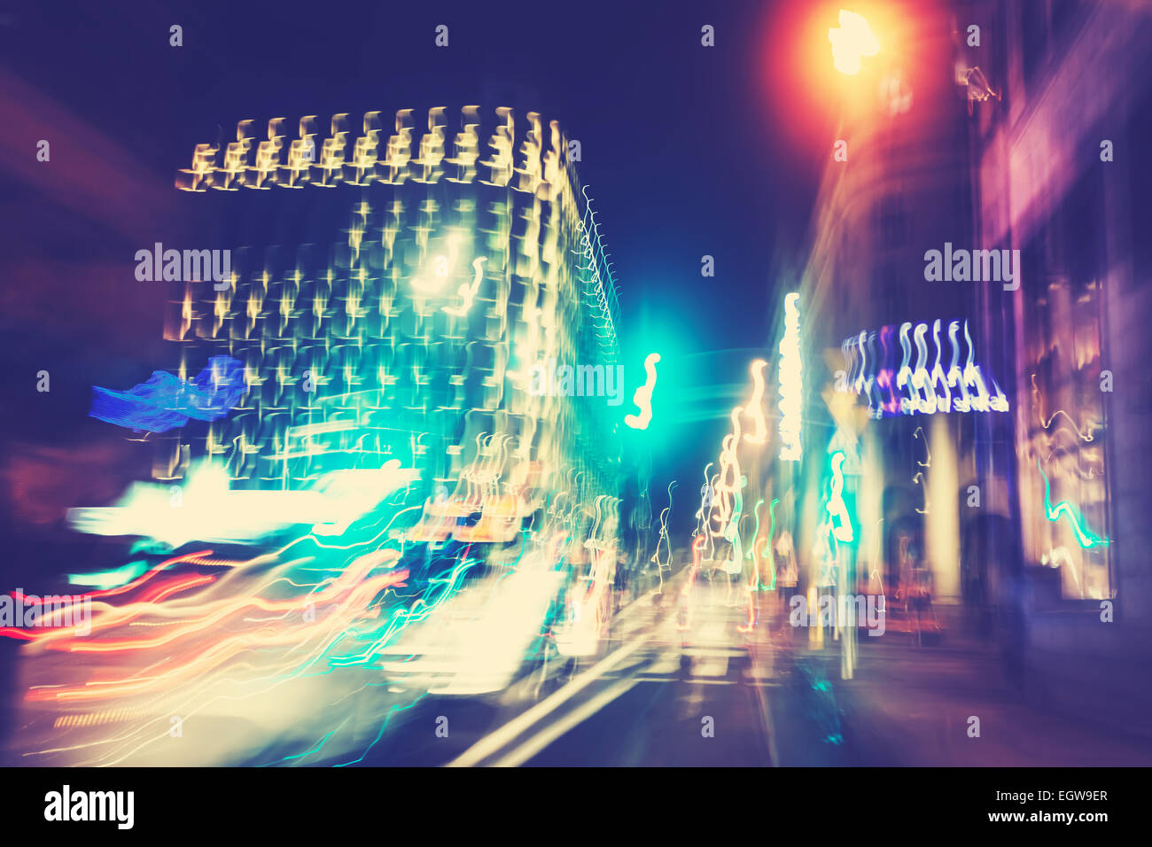 Retro filtered city traffic lights in motion blur. - Stock Image
